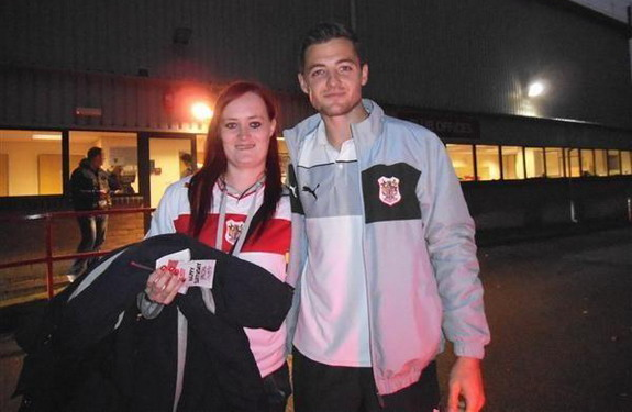 Robbie Rogers poses with a female fan during his spell with Stevenage