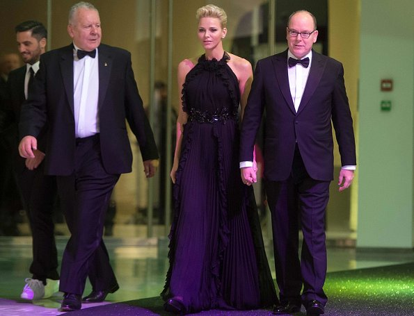 Princess Charlene is wearing her Gucci gown first worn in 2012 at 2017 World Rugby Award ceremony. Dior earrings