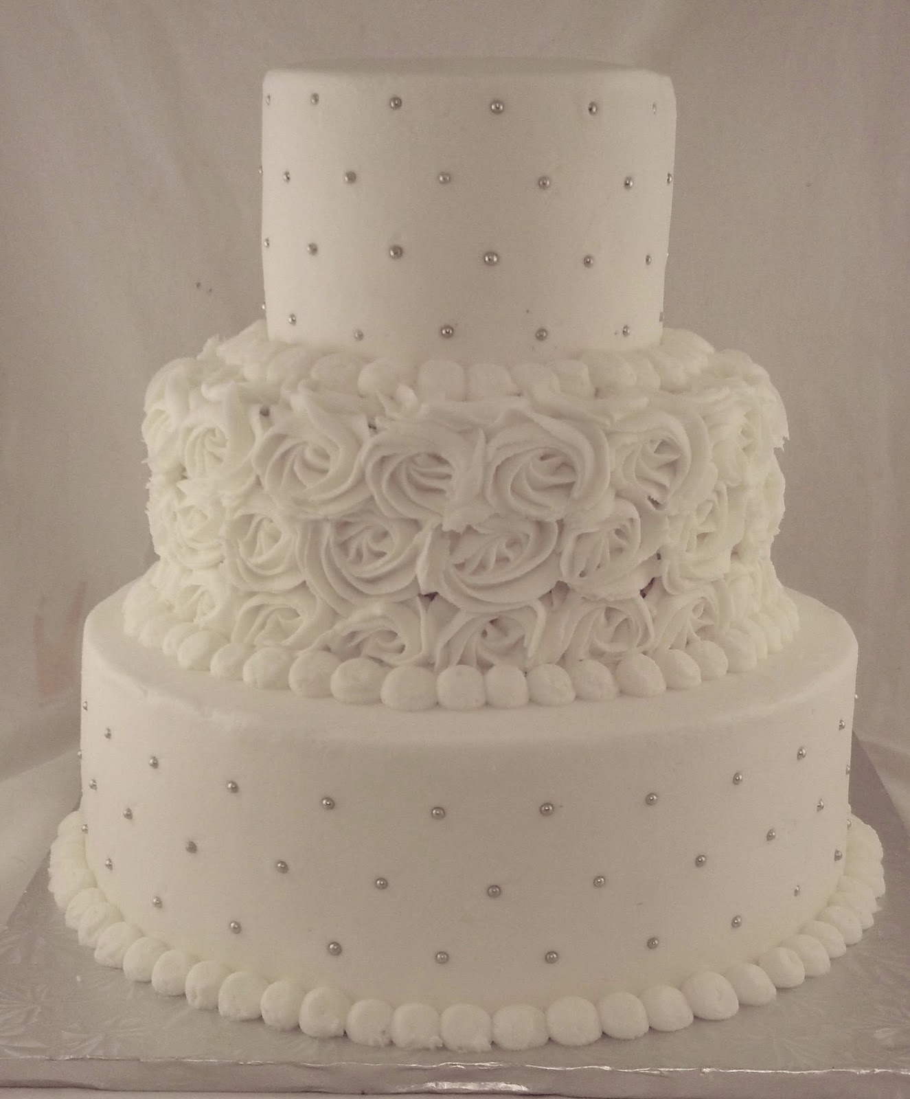 Dots And Ercream Roses Wedding Cake