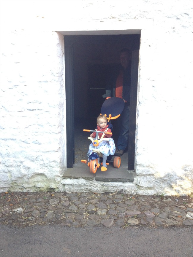 Child on bike in doorway