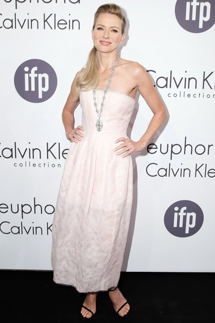Naomi Watts in a light Calvin Klein Collection strapless dress with a Bulgari necklace at Cannes 2014
