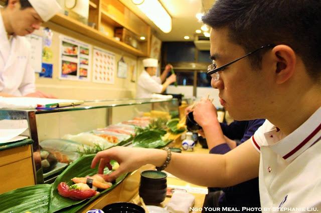 Jonathan Ngo (Ngo Your Meal) eating sushi at Yamazaki in Tokyo, Japan
