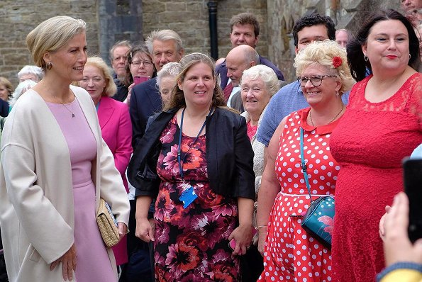Sophie Countess of Wessex wore Dolce & Gabbana pink sleeveless wool dress and Prada cashmere coat, Prada pumps