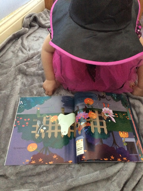 Sophia reading the halloween book