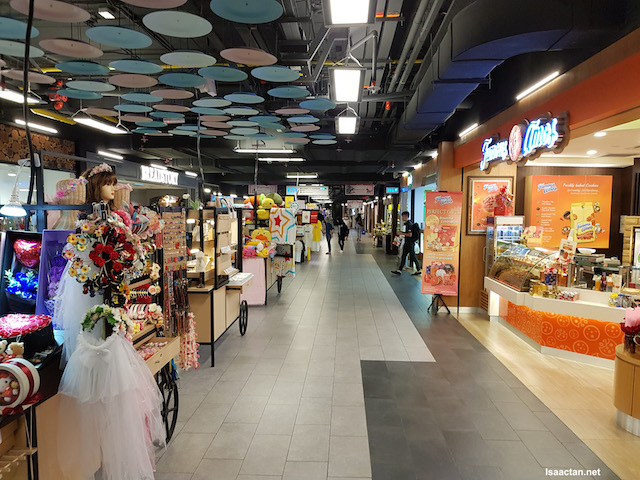 Walking around the spacious corridor of IPC Shopping Centre while thinking what to eat!