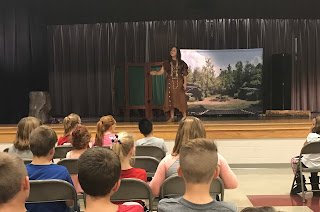 Students watching the Tecumseh Performance