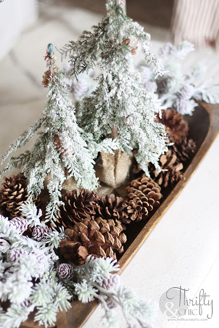 Christmas living room decor and decorating ideas. Christmas decor ideas for dough bowls. Farmhouse Christmas decor. Flocked Christmas trees. Shiplap wall and Christmas. Antique styled wood mantel. Wood mantel Christmas decor.