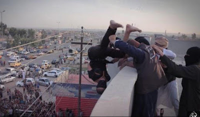 A gay man is thrown off a building top by ISIS militants in Iraq in Oct. 2015