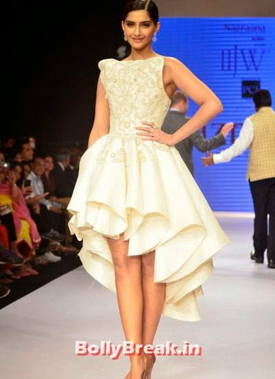 Sonam Kapoor wore white sleeve less gown and diamond earrings, Sonam Kapoor Pics in White Gown Dress at IIJW Fashion Show 2014
