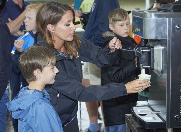 Princess Marie visited Helsingor Holiday Village. Princess style, diamond earrings By Malina boot, Hugo Boss blouse