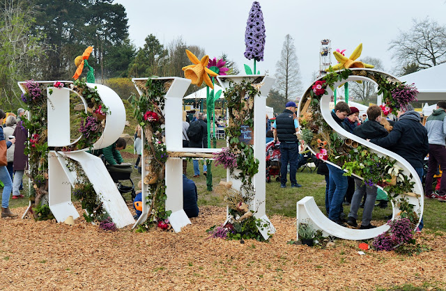 RHS in large letters filled with flowers.