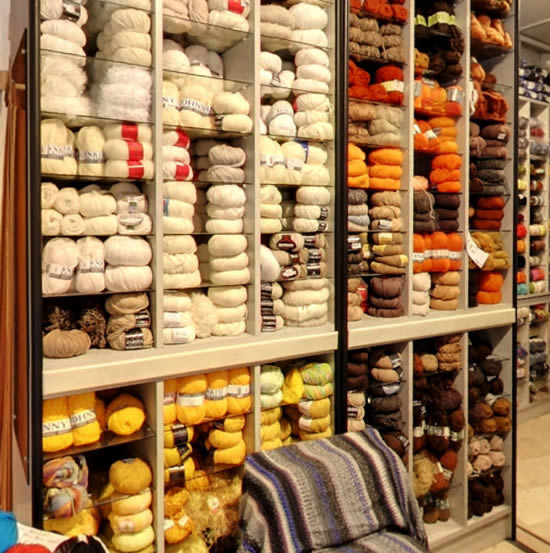 Shopping in Bologna, Italy. Wool whops in Bologna (photo by: Casa Della Lana Di Samoggia Franca) | Happy in Red
