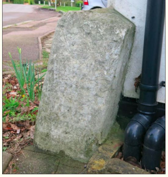 The milestone leaning outside Swan Lodge Image by Peter Miller