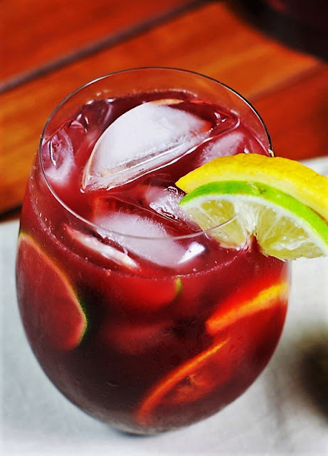 Wine Glass of Triple Citrus Sangria with Lemon Lime Wedge Garnish Image