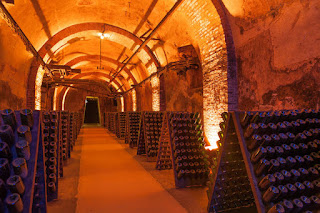Rows of champagne bottles in Reims cellar,  Champagne
