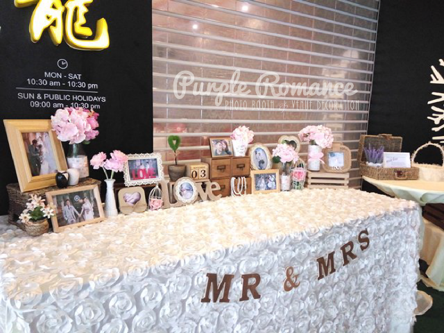 photo booth backdrop, rack, wooden crates, love corner, photo table display, elegant, grand, lavendar, rustic, flowers, floral, garden, live, laugh love, logo, event styling, annual dinner, instant print service, planning, props, photo taking, green carpet, weddings