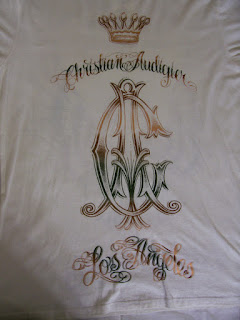 RARE CHRISTIAN AUDIGiER logo city of angels WINGS white GOLD T SHIRT L $150
