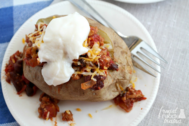 Hearty baked potatoes are simply steamed in the microwave, & then topped with a homemade chili that's packed with turkey and beans in these Turkey Chili-Stuffed Baked Potatoes.