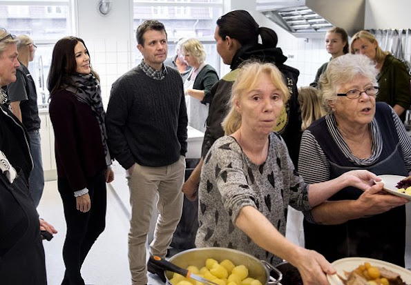 Crown Prince Frederik and Crown Princess Mary visited  the Morning Café for the Homeless (Morgencafé for Hjemløse). Princess Mary wore Prada jacket, Gianvito Rossi pumps