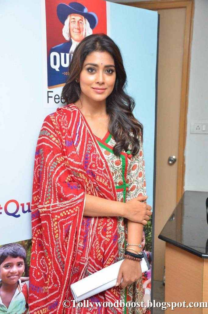 Shriya Saran Stills At Quaker Feed A Child Campaign In Red Dress
