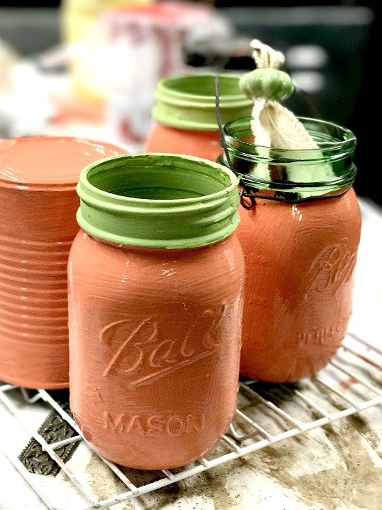 cans and mason jars painted orange
