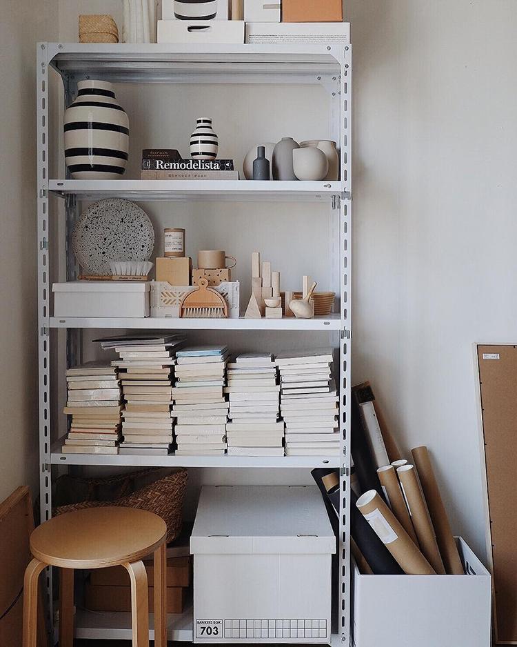 INSTAGRAM CRUSH: Yitai Hu. Metallic bookcase styling