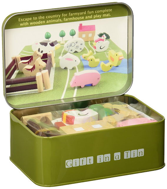 A tin with a mini farm set inside