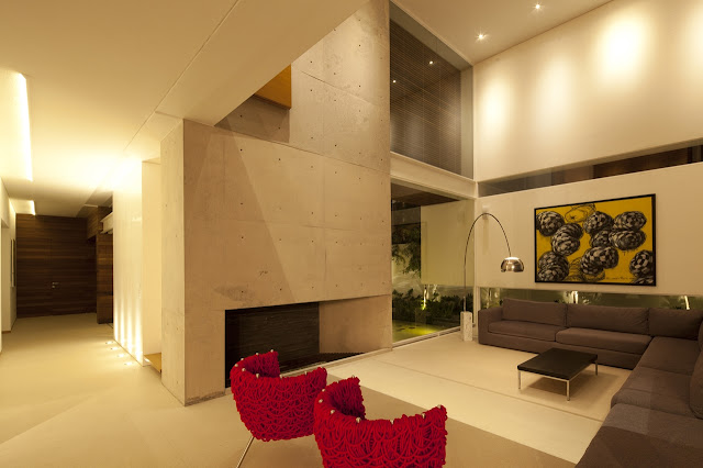 Modern living room of FF House in Mexico at night