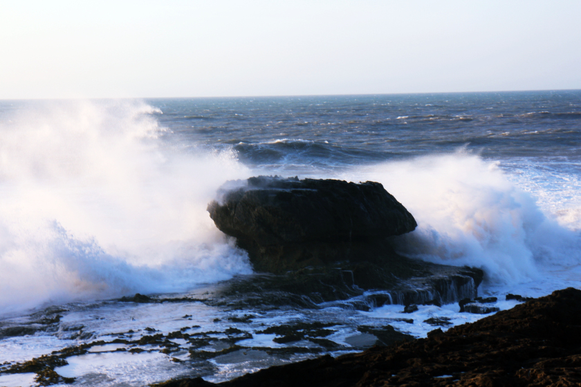 Waves crashing against a rock in Essaouria, Morocco