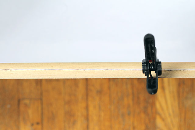 Use a dowel rod to hang engineered prints