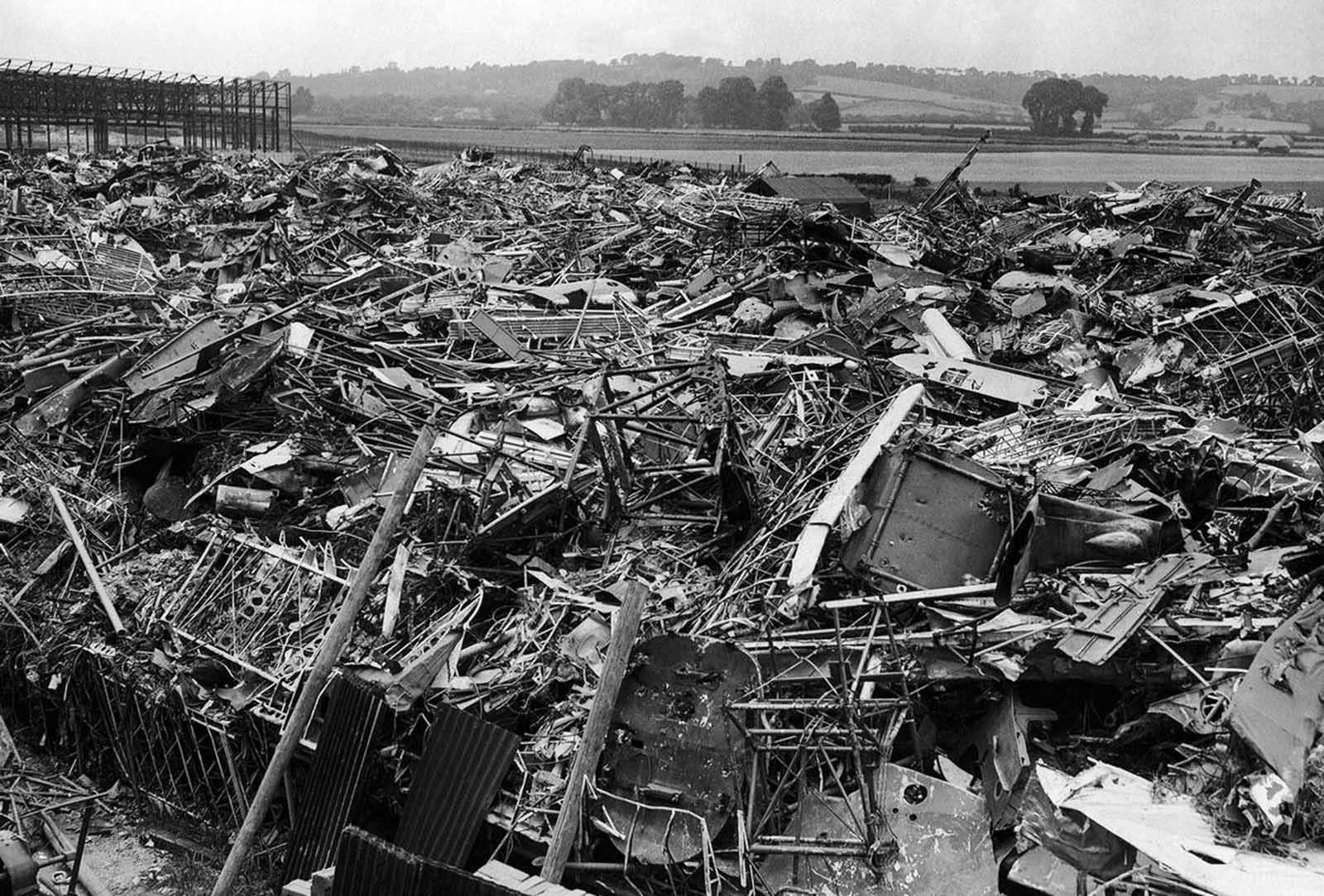A huge scrap heap where German planes, brought down over Great Britain, were dumped, photographed on August 27, 1940. The large number of Nazi planes downed during raids on Britain made a substantial contribution to the national scrap metal salvage campaign.