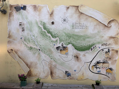 A mural in Vilminore showing trail to the Gleno Dam.