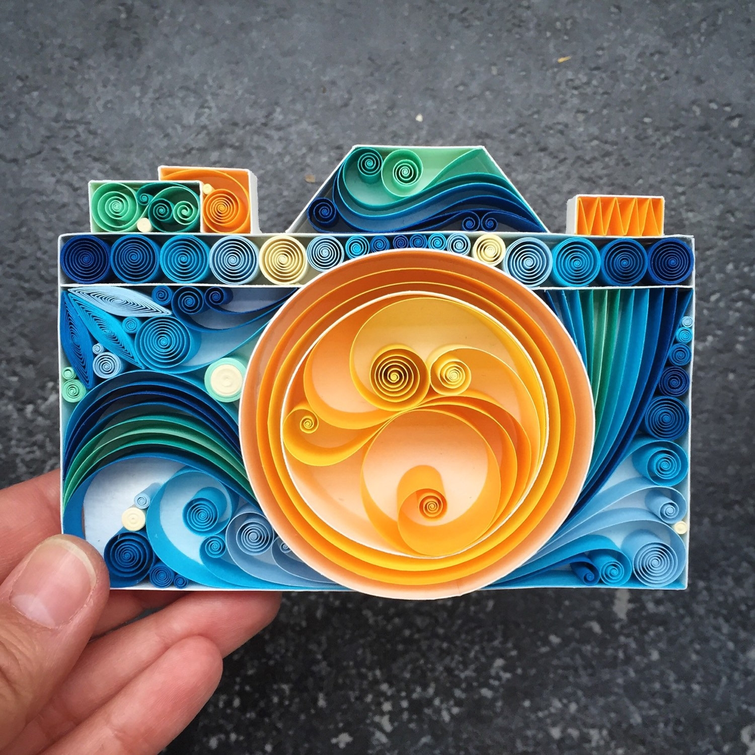 11-Digital-Camera-Sena-Runa-Beautiful-Designs-Accomplished-with-Paper-Quilling-Art-www-designstack-co