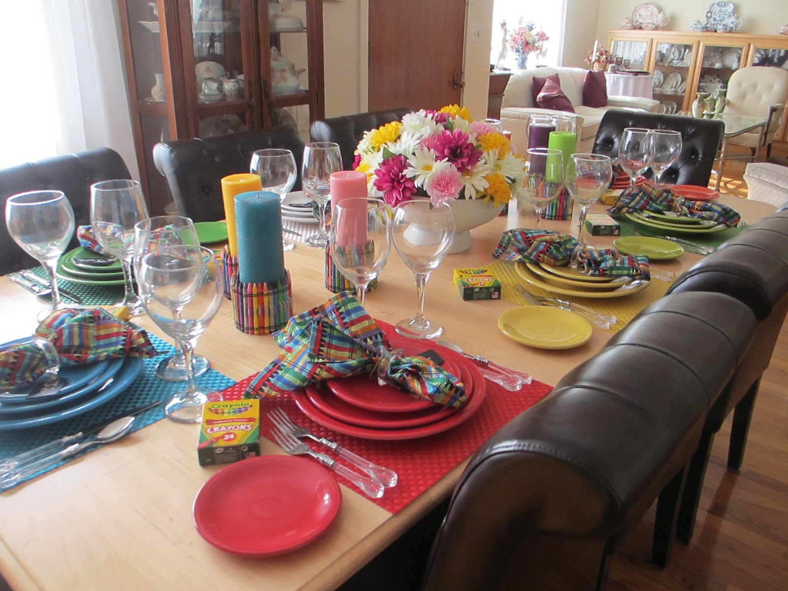 Every place setting is set with a different color of  Fiesta  dinnerware & The Welcomed Guest: Fiesta(ware) and Crayons Tablescape