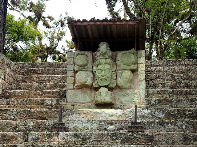 Mayan face statue carving at the temple ruins outside Copan, Honduras