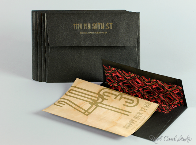 Letterpress printing, New Year card, cherry wood veneer card, black glitter envelope, red ikat