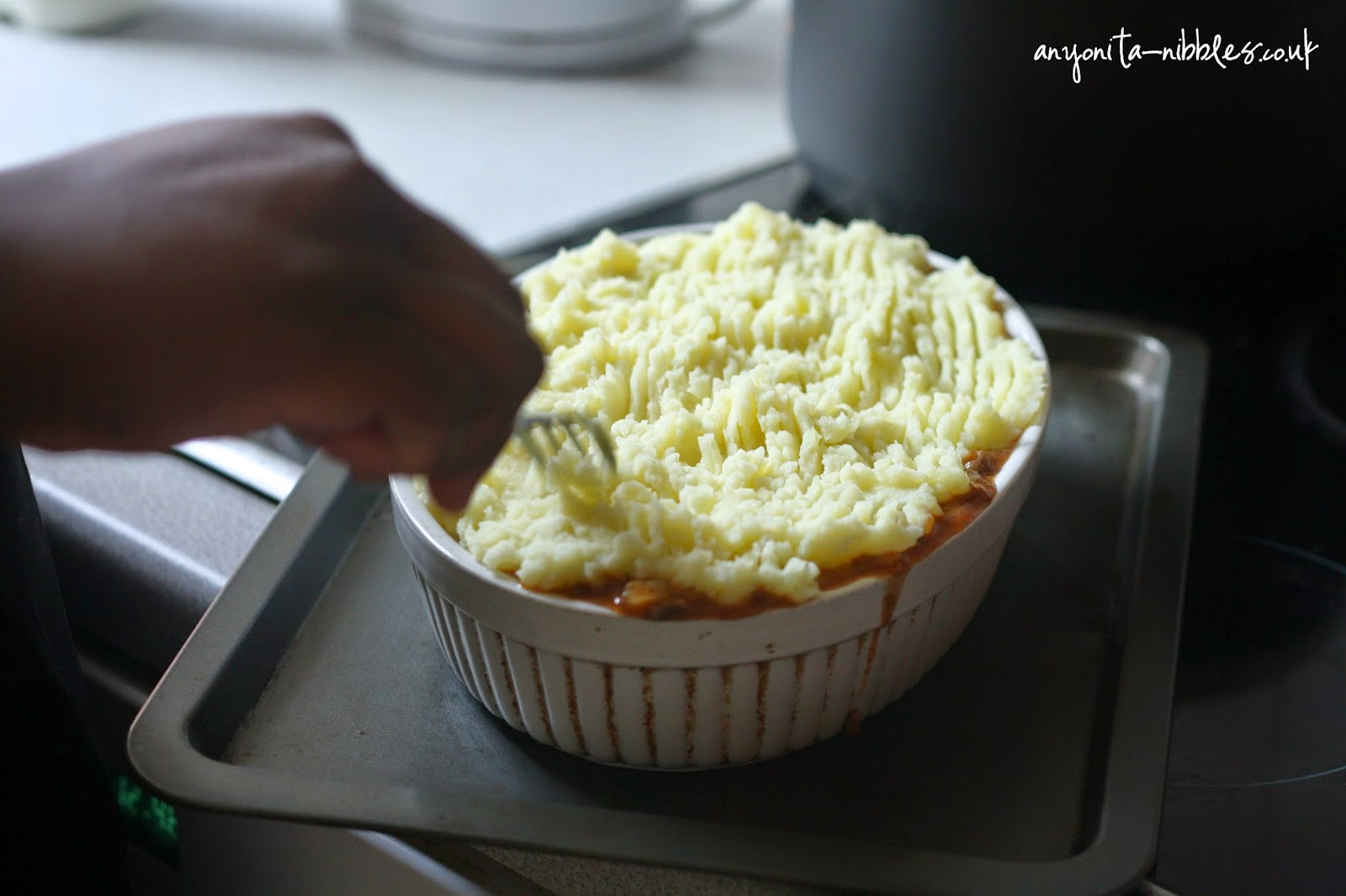 Adding texture to the mashed potatoes for cottage pie from anyonita-nibbles.co.uk