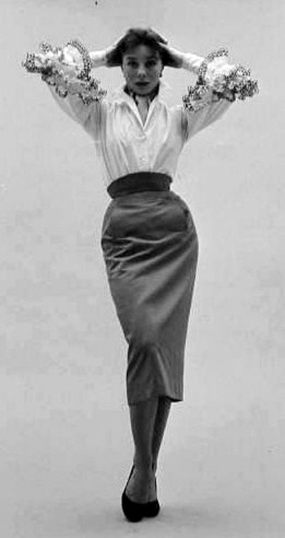 Model Bettina Graziani in Hubert de Givenchy Blouse and Gabardine Skirt
