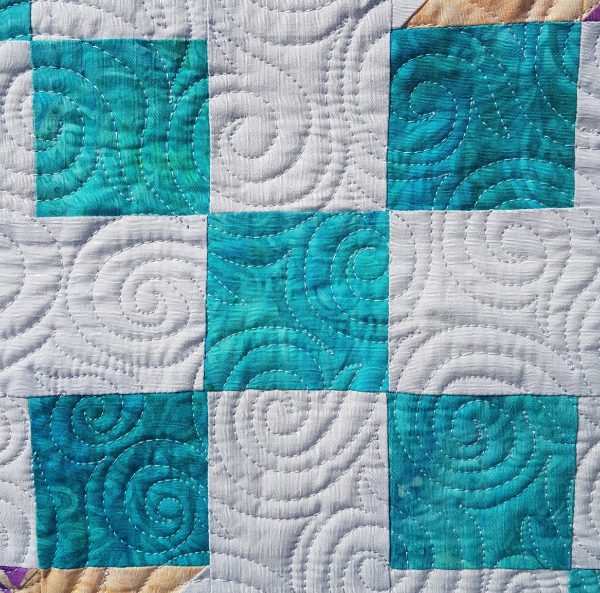 Swirl hooks free motion quilting | DevotedQuilter.com