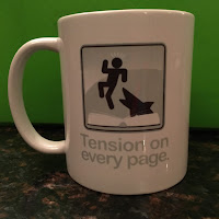 Mug that says Tension on Every Page