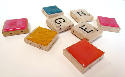 Scrabble tiles covered with colored plastic