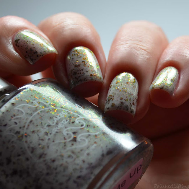 white crelly nail polish with flakies and shimmer