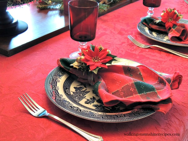 Blue Willow Plates and Red Stemware Glasses and How to Set a Festive Table for Christmas on a Budget from Walking on Sunshine.