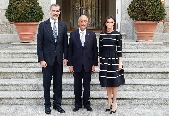 Queen Letizia wore Carolina Herrera striped fit and flare dress. Portuguese president Marcelo Rebelo De Sousa visited Madrid