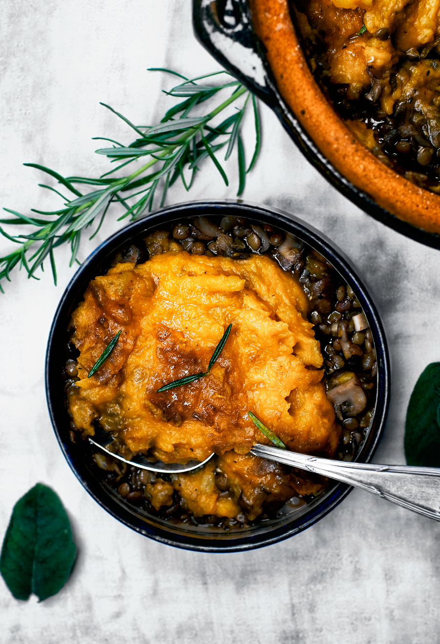 This vegan lentil shepherd's pie is a modern, plant based version of the classic - a rich mushroom and lentil base, topped with creamy mashed potato and pumpkin. Total cold weather comfort food.