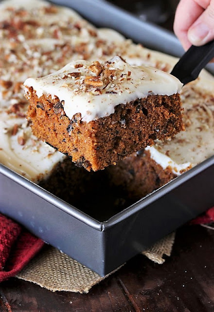 Serving a Piece of Carrot Cake Sheet Cake Image