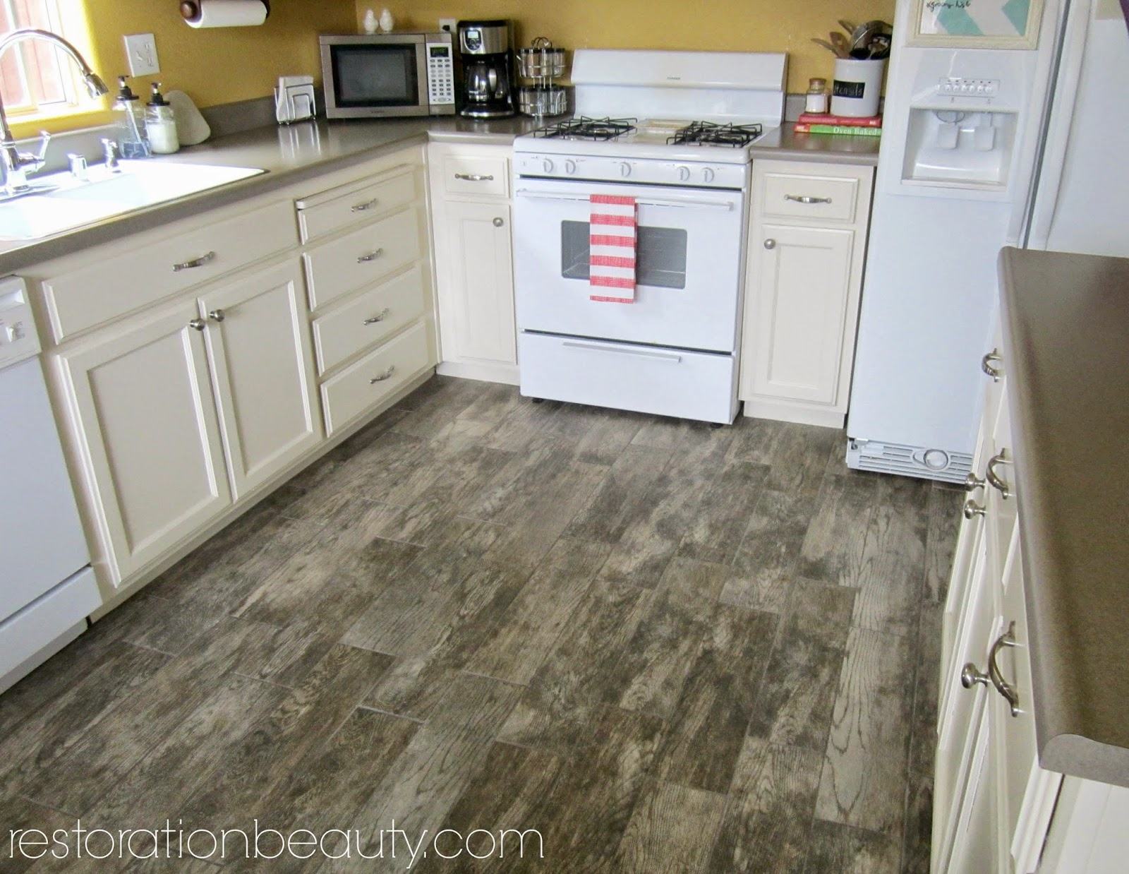 wood floor tile in kitchen.  Restoration Beauty Faux Wood Tile Flooring In The Kitchen