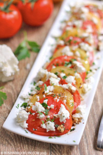 Summer Tomato Feta Salad @ BusyInBrooklyn.com, another Pretty Way to Serve Tomatoes @ AVeggieVenture.com.