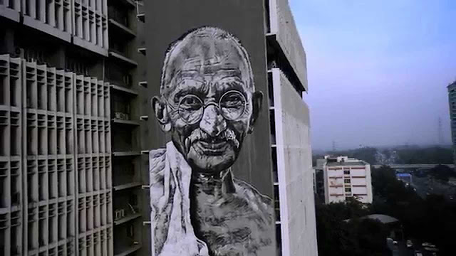 Graffiti: Styles| artists | and artworks/Mural of Mahatma Gandhi on Polish headquarter, Delhi