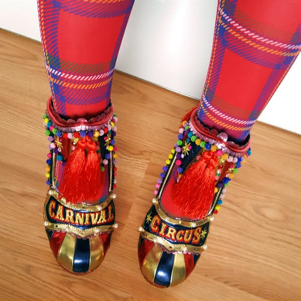 striped metallic toes of shoes with circus and carnival light up signs across the foot and removable tassel ankle cuff